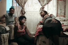 Tshililo (right) and her friends share a one-roomed apartment in Cape Agulhas Esselen Street, Hillbrow