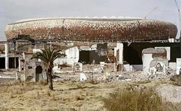 The ruins of Shareworld and FNB-Soccer City Stadium. Shareworld, intended as a theme-park to the people of Soweto, was built and went bankrupt in the late 1980s